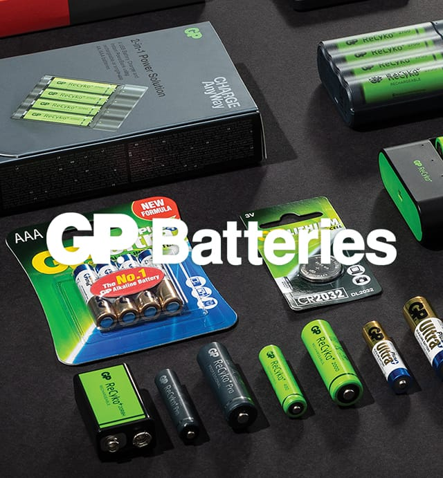 GP batteries logo over batteries on black table