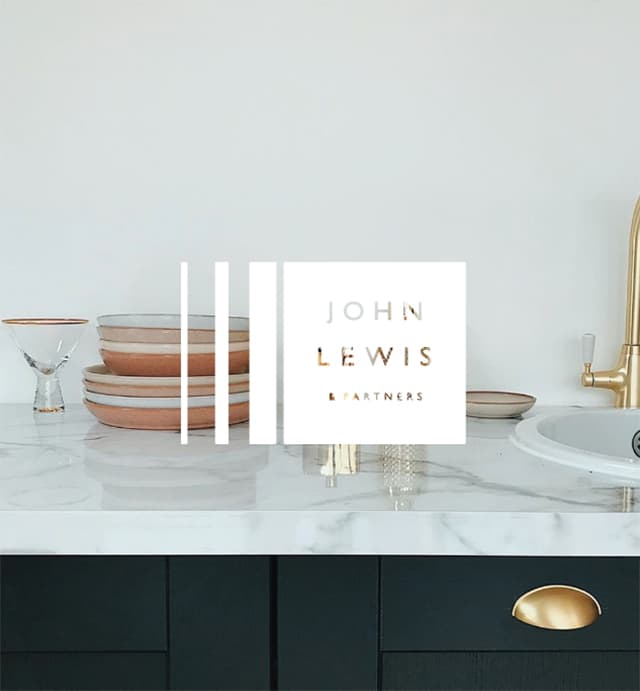 Marble worktop with dishes and John Lewis & Partners logo
