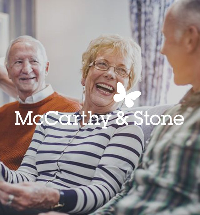 Elderly people laughing with McCarthy & Stone logo overlay