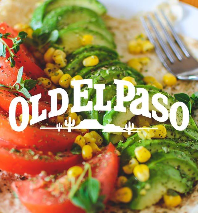 Sliced avocado and tomato closeup with Old El Paso logo overlaid