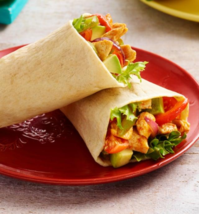 Old El Paso Chicken Fajita tortilla pockets closeup on a red plate