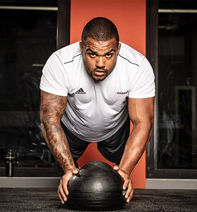 England Rugby player Kyle Sinckler training with gym ball